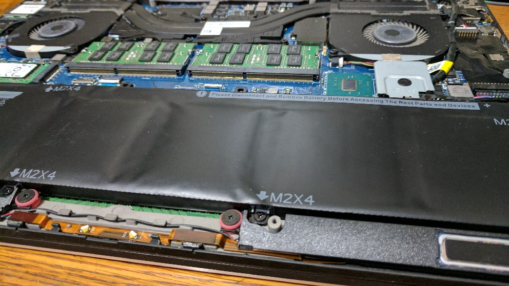 Fixing a raised trackpad on a Dell XPS 15 (9550)